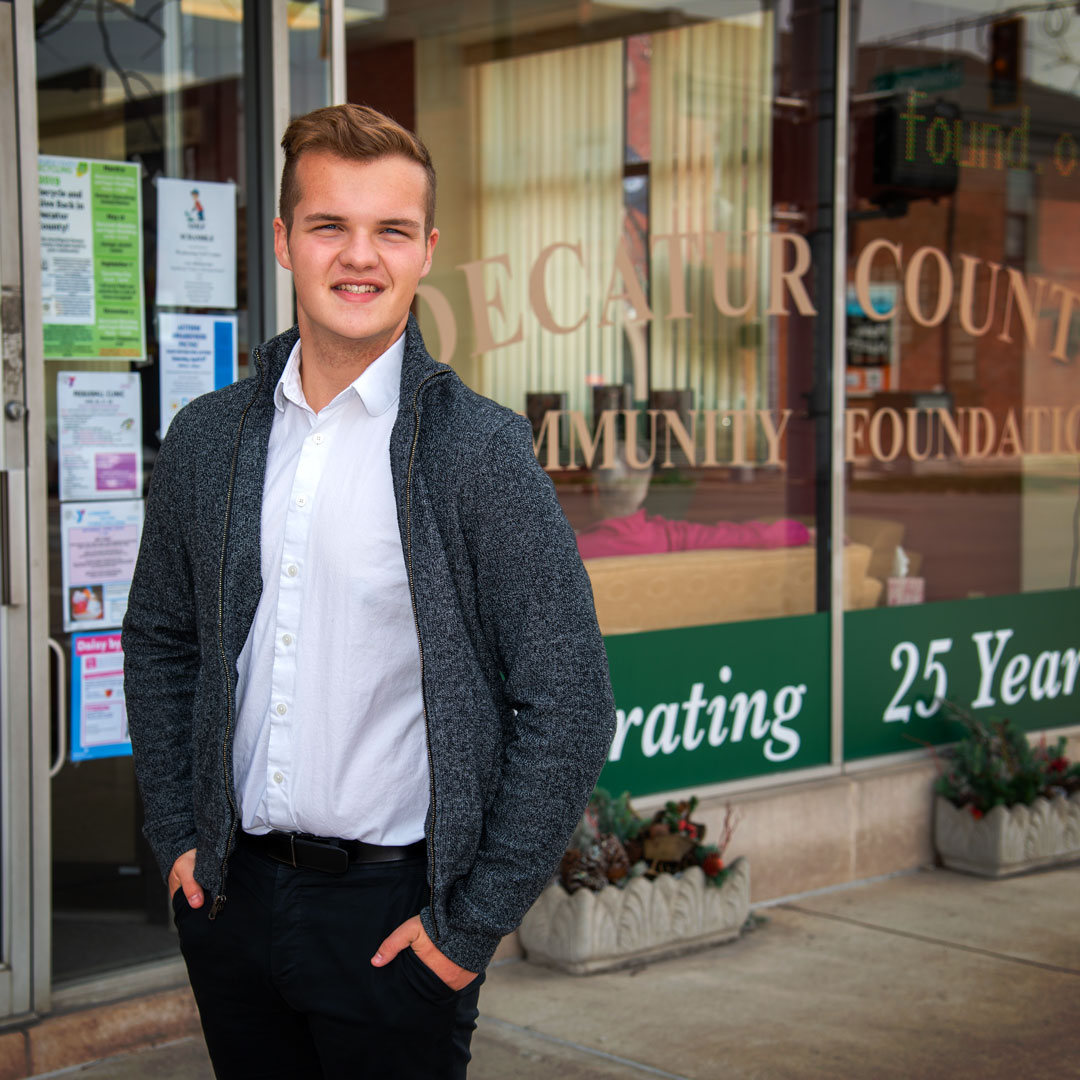 Alex Sefton smiling while standing in front of the Decatur County Community Foundation.